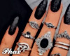 rings and black nails